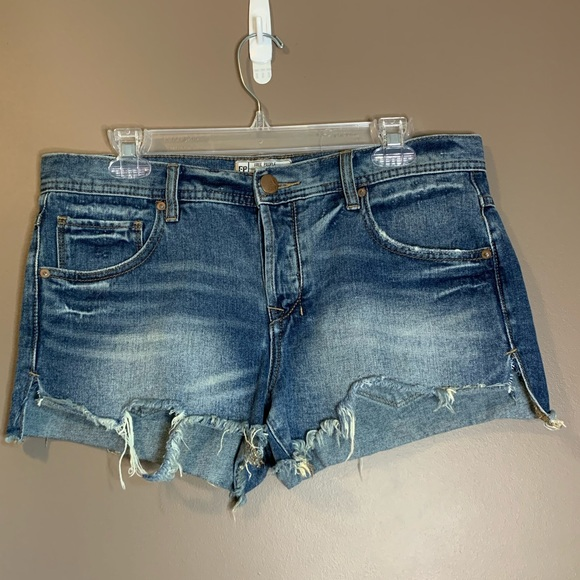 Free people distressed jean shorts. Size 29.
